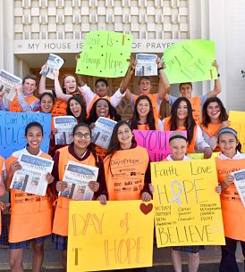 Day of Hope students sell newspapers